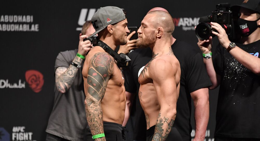 Dustin Poirier and Conor McGregor of Ireland face off during the UFC 257 weigh-in at Etihad Arena on UFC Fight Island on January 22, 2021 in Abu Dhabi, United Arab Emirates.