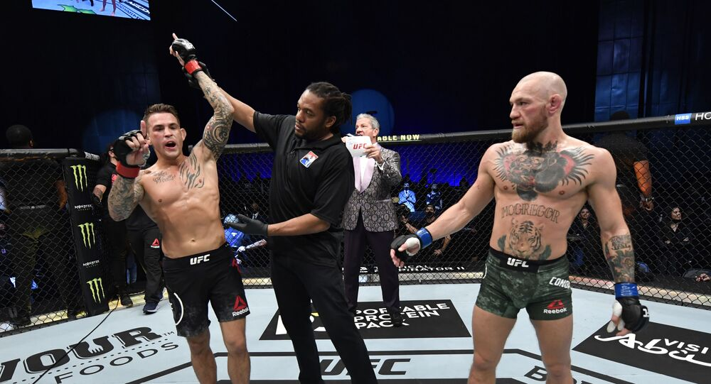 Abu Dhabi, United Arab Emirates; Dustin Poirier reacts after his knockout victory over Conor McGregor of Ireland in a lightweight fight during the UFC 257 event inside Etihad Arena on UFC Fight Island.