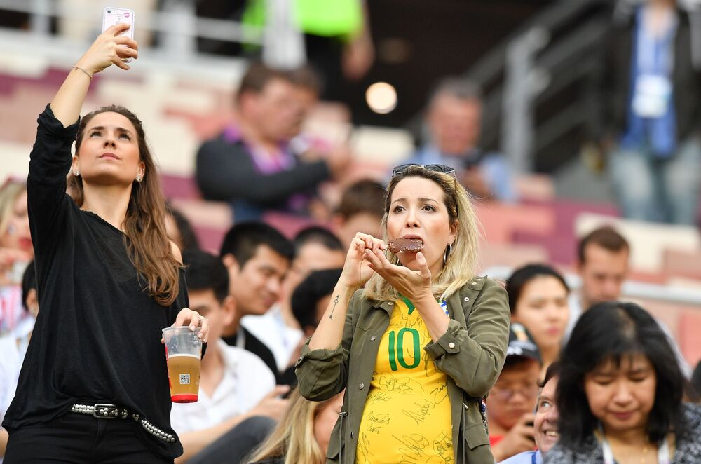 A woman eats ice cream before the Croatia-England match at the 2018 World Cup in Russia.