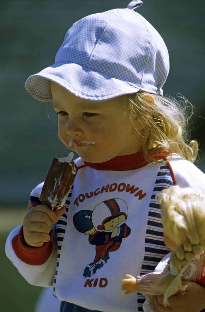 A girl eats an Eskimo pie in Estonia, 1990.