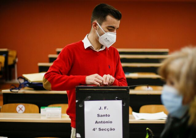 A man wearing a protective mask prepares the site for the beginning of the Portugal's presidential election voting, amid the coronavirus disease (COVID-19) pandemic in Lisbon, Portugal, January 24, 2021.