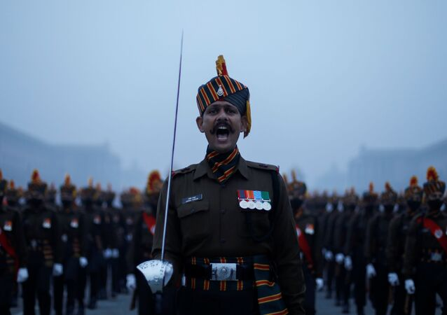 Army soldiers take part in the rehearsal for the Republic Day parade during the early morning, in New Delhi, India, 18 January 2021.
