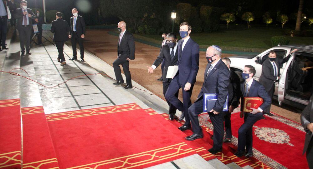 Israeli National Security Adviser Meir Ben-Shabbat (front R), who led the Israeli delegation, and U.S. White House Senior Adviser Jared Kushner are seen during a visit to Rabat, Morocco, December 22, 2020.