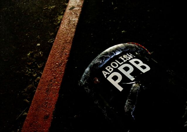 A discarded shield calling for the abolishment of the Portland Police Bureau sits on the ground after federal law enforcement officers used crowd control munitions against protesters rallying to abolish ICE after the inauguration of U.S. President Joe Biden, outside of an ICE facility in Portland, Oregon, U.S. January 20, 2021.
