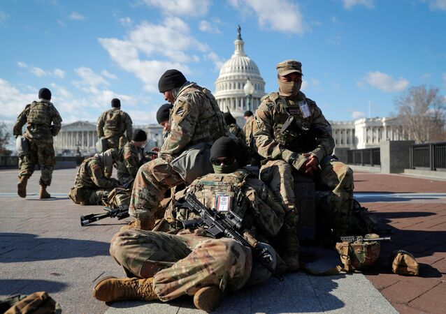National Guard troops gather in front of the U.S. Capitol one day ahead of President-elect Joe Biden's Inauguration in Washington, U.S. January 19, 2021.