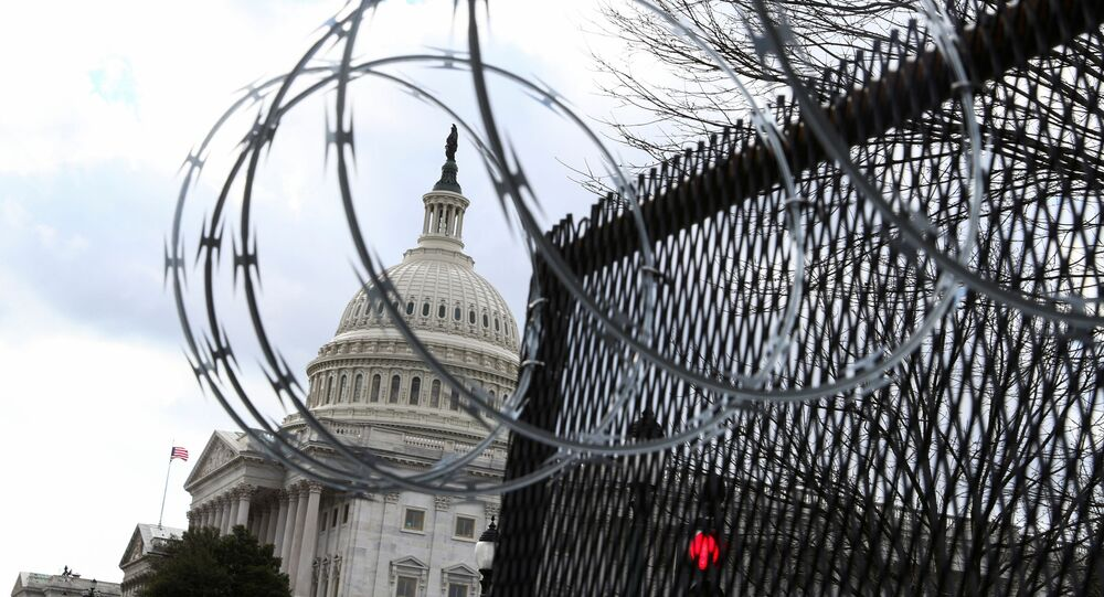 Barbed wire is seen on a fence as U.S. President-elect Joe Biden arrives at the U.S. Capitol for his inauguration as the 46th President of the United States, in Washington, U.S., January 20, 2021.