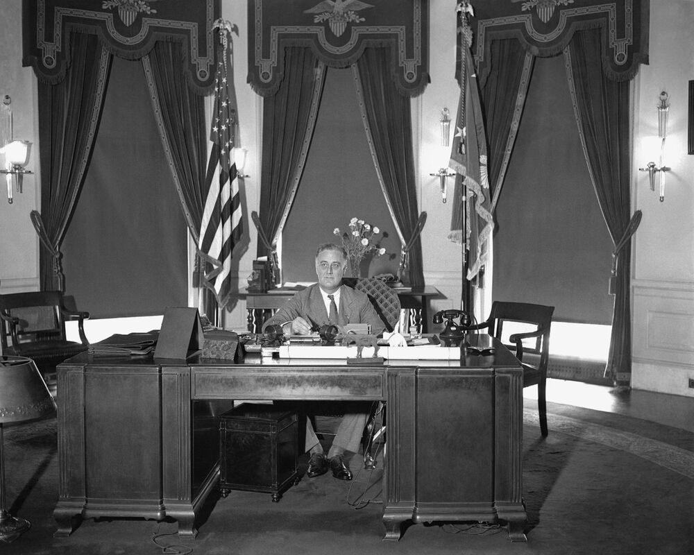 President Franklin D Roosevelt is seen sitting at his desk in the White House, 27 May 1933.