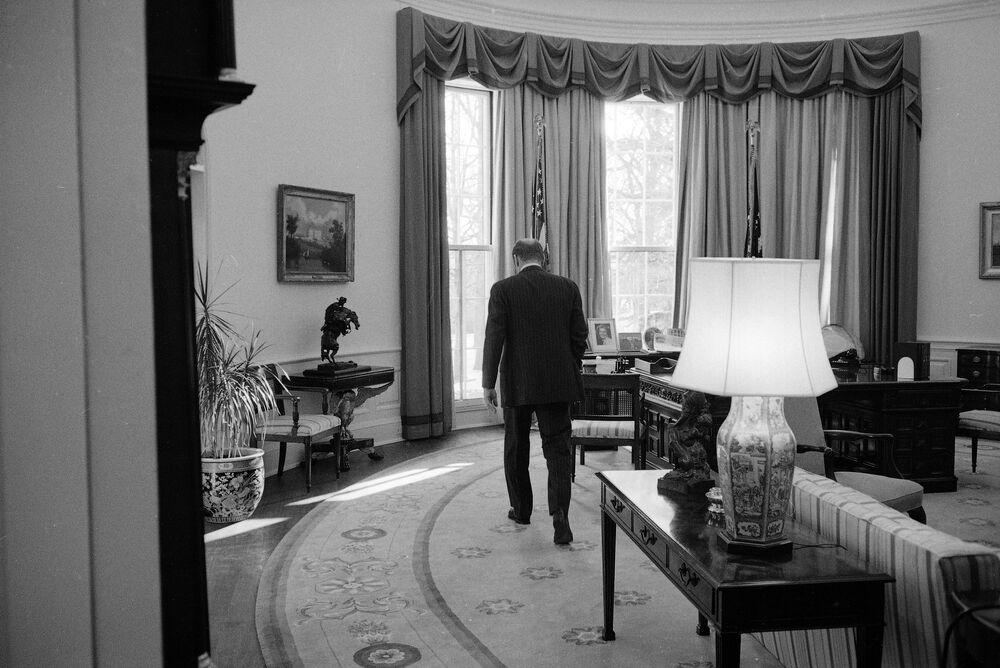 President Gerry Ford strides across the Oval Office of the White House, 19 January 1977, as he and the other members of the first family prepare to leave the White House, as President-elect Jimmy Carter is sworn in.