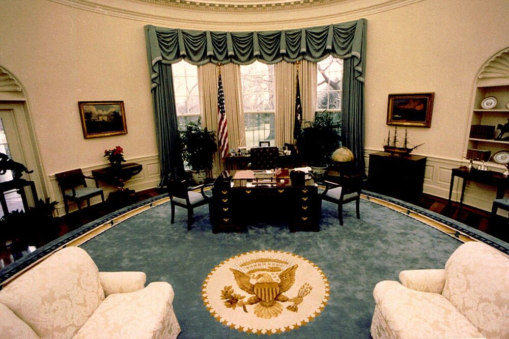 This 22 January 1990 file photo released by the White House shows President George HW Bush's Oval Office at the White House in Washington. Bush's redecoration of the Oval Office included a new rug with a gold Presidential Seal, new draperies, a coffee table, and two tall armchairs. Presidents typically put their own touches on the Oval Office early in their terms.