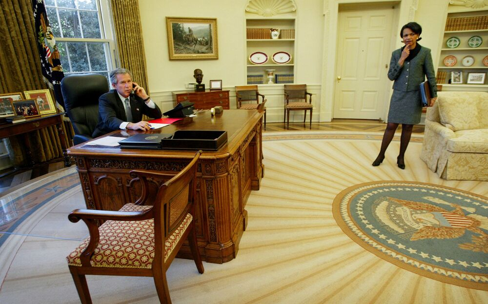 President  Bush, left, speaks with Spanish Prime Minister Jose Maria Aznar by phone from the Oval Office of the White House as National Security Adviser Condoleezza Rice, right, looks on 10 March 2003.