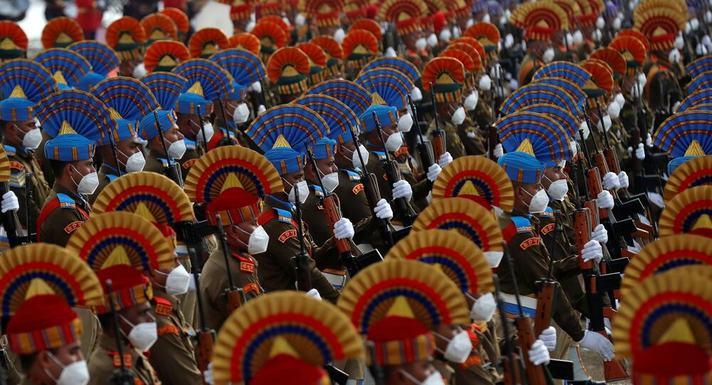 Indian security forces personnel wearing protective face masks take part in a full dress rehearsal for the Republic Day parade in Srinagar, 24 January 2021.