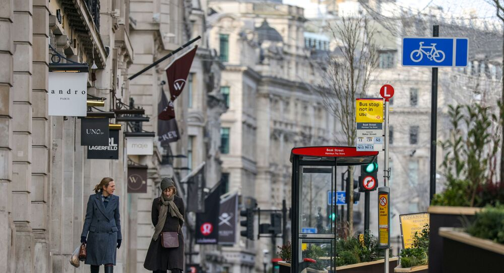 Two women walk down Regent Street, one of London's main shopping streets, as Britain continues its third COVID-19 lockdown, in London, Britain, January 17, 2021.
