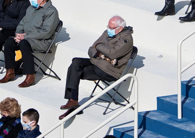 US Senator Bernie Sanders sits socially distanced as he attends the Presidential Inauguration of Joe Biden on the West Front of the US Capitol in Washington, DC, 20 January 2021.