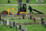 Workers dig graves at a cemetery, amid the spread of the coronavirus disease (COVID-19) pandemic, in London, Britain, January 11, 2021