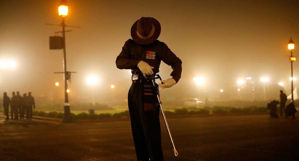 An Army soldier checks his sword during the rehearsal for the Republic Day parade, in New Delhi, India January 18, 2021