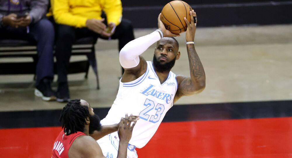 LeBron James #23 of the Los Angeles Lakers puts up a jump shot ahead of James Harden #13 of the Houston Rockets during the first quarter of a game at Toyota Center on January 10, 2021 in Houston, Texas.