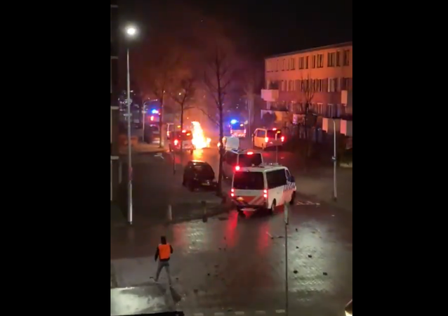 Screenshot of a video showing flames on a city street in the Netherlands during anti-lockdown protests