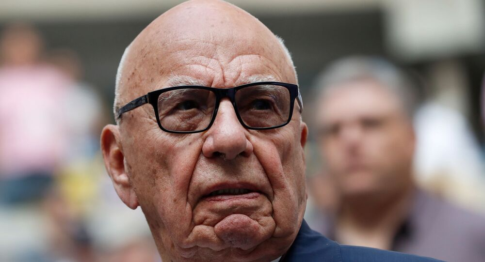 Rupert Murdoch, Chairman of Fox News Channel stands before Rafael Nadal of Spain plays against Kevin Anderson of South Africa