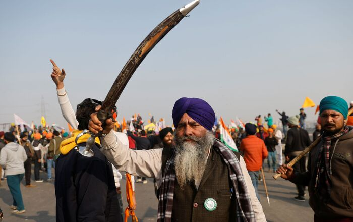 A farmer holding a sword looks on after police stopped farmers as they take part in a tractor rally to protest against farm laws on the occasion of India's Republic Day in Delhi, India, January 26, 2021
