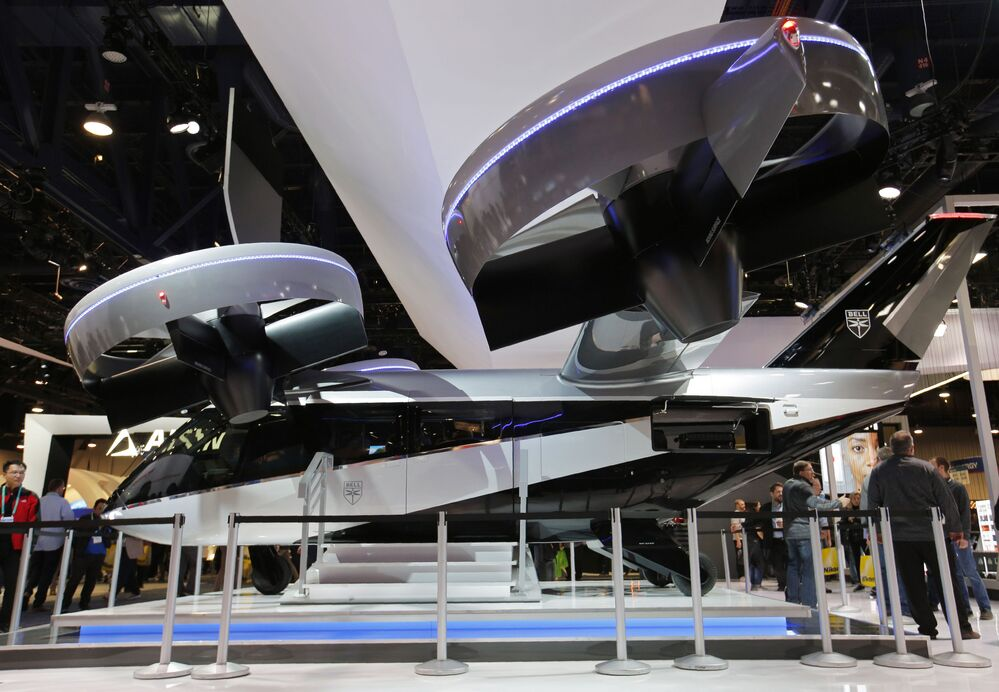 The Bell Nexus 4EX, a four-duct electric or hybrid-electric air taxi, on display in the Bell booth at the CES tech show, Wednesday, 8 January 2020, in Las Vegas.