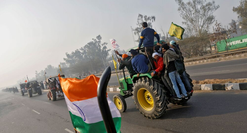 Farmers take part in a tractor rally to protest against farm laws on India's 72nd Republic Day in Delhi on 26 January 2021.