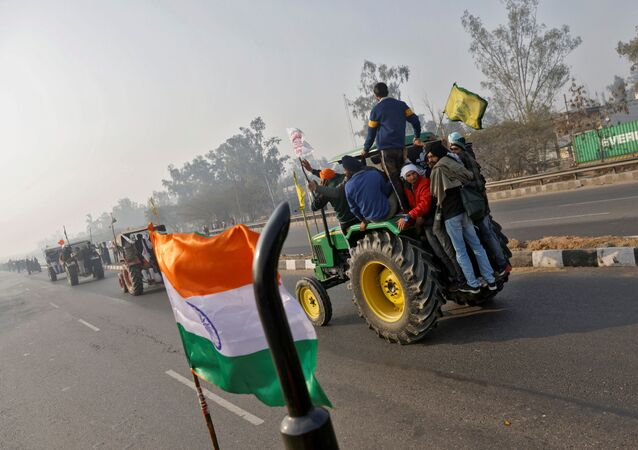 Farmers take part in a tractor rally to protest against farm laws on the occasion of India's Republic Day in Delhi