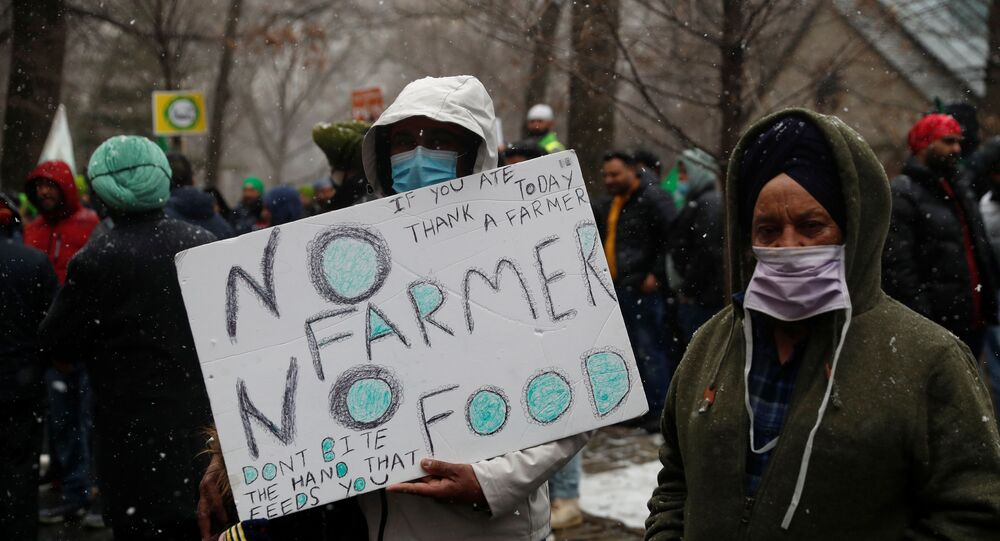 People demonstrate in solidarity with Indian famers protesting against agricultural reforms outside the Indian Consulate in the Manhattan borough of New York, U.S., January 26, 2021. REUTERS/Shannon Stapleton