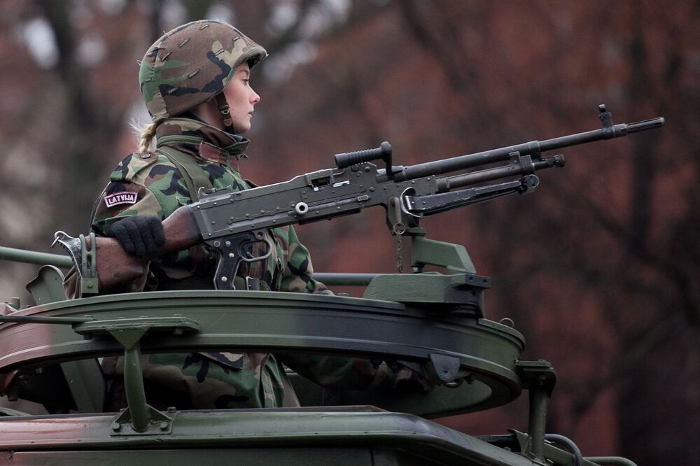 A female soldier during a parade of the Latvian National Armed Forces, 18 November 2012.