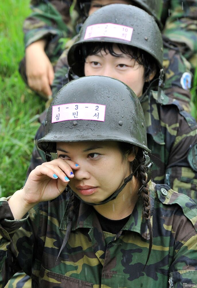 A South Korean woman reacts during a training camp for civilians at a Special Warfare Command military base in Seoul on 4 August 2011.