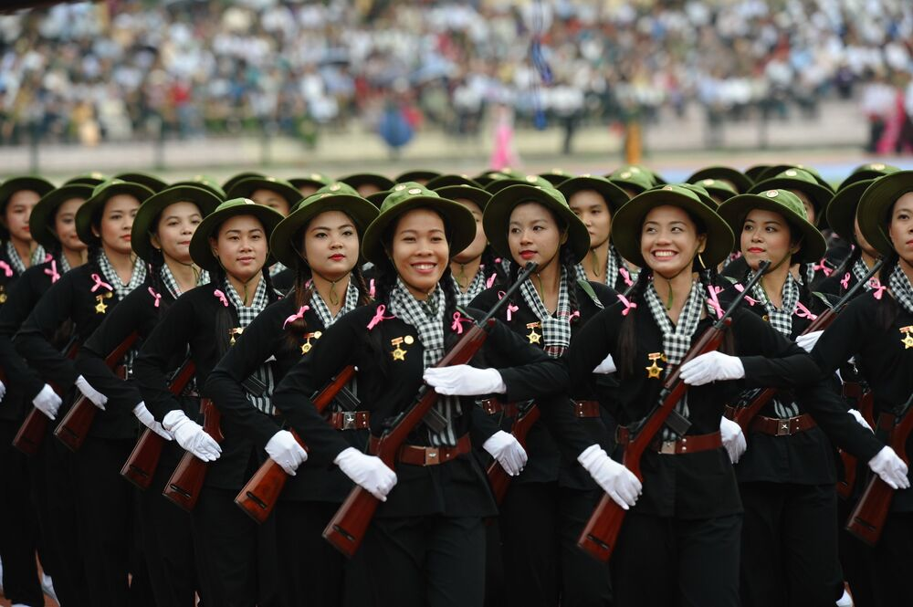 Women dressed as female Vietcong soldiers during the Vietnam War parade during official celebrations of the 60th anniversary of Vietnam's Dien Bien Phu victory over France at a stadium in the northwestern town of Dien Bien Phu on 7 May 2014.