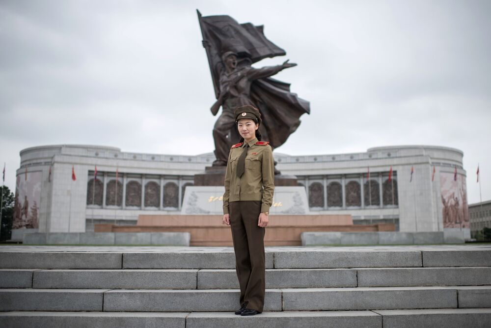 Tour guide and Korean People's Army (KPA) captain Choe Un-Jong (26) poses for a portrait at the War Museum, or Victorious Fatherland Liberation War Museum, in Pyongyang, 28 July 2017.