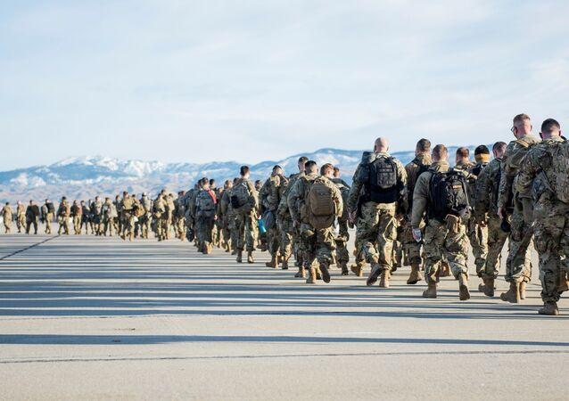 Idaho National Guard soldiers and airmen form a line to depart for Washington, D.C. to provide additional security with the inauguration of U.S. President-elect Joe Biden, in Boise, Idaho, U.S. January 15, 2021. Picture taken January 15, 2021.  U.S. National Guard/Master Sgt. Becky Vanshur/Handout via REUTERS