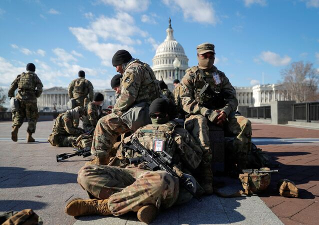 National Guard troops gather in front of the U.S. Capitol one day ahead of President-elect Joe Biden's Inauguration in Washington, U.S. January 19, 2021. REUTERS/Mike Segar/File Photo