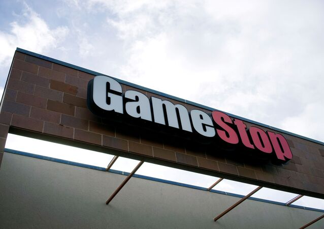 The GameStop store sign is seen at its shop in Westminster, Colorado, 14 January 2014.