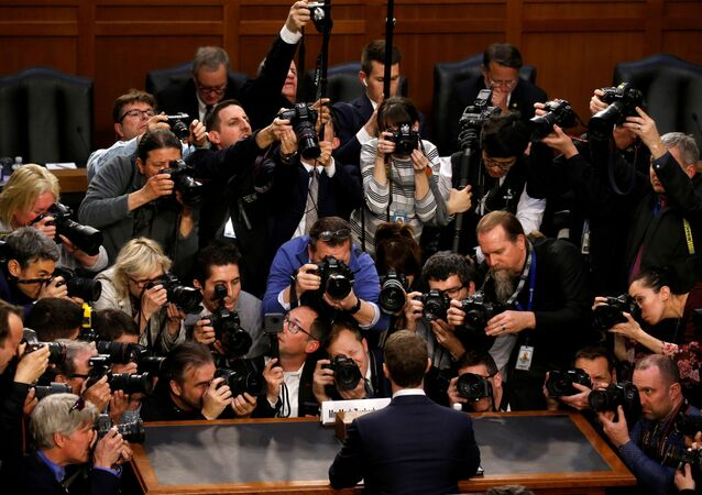 Facebook CEO Mark Zuckerberg is surrounded by members of the media as he arrives to testify before a Senate Judiciary