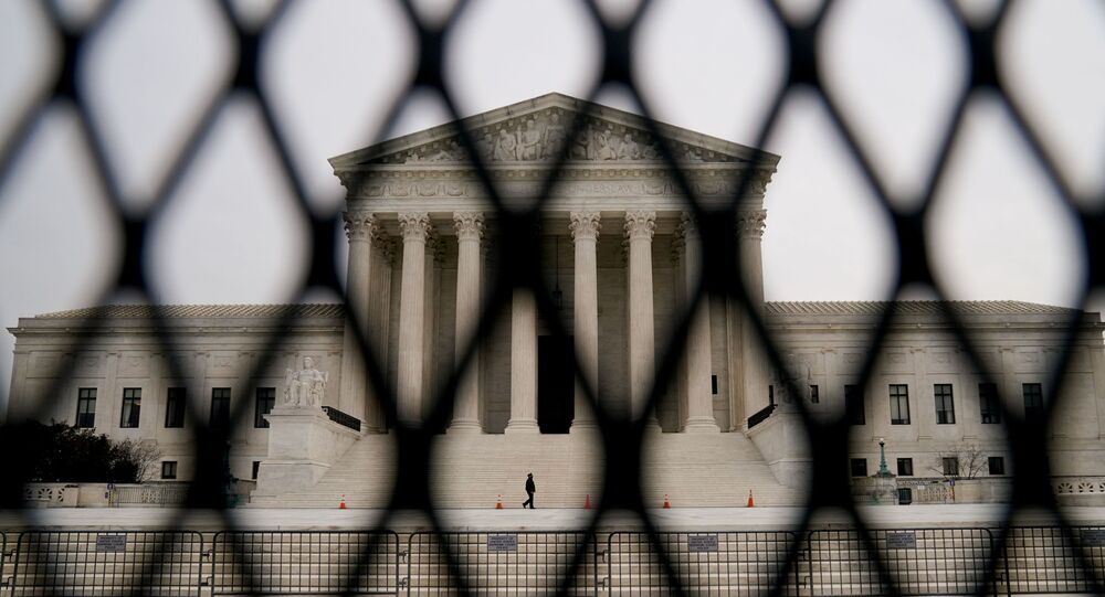 Security fencing surrounds the U.S. Supreme Court