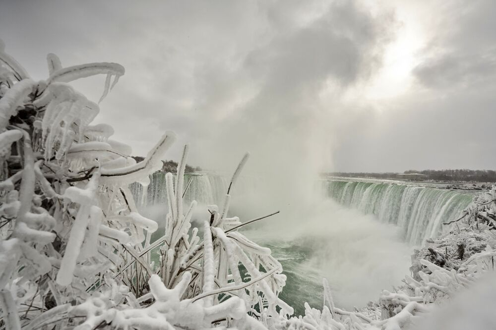 A bush is encrusted with ice at the Horseshoe Falls in Niagara Falls, Ontario, on 27 January 2021.