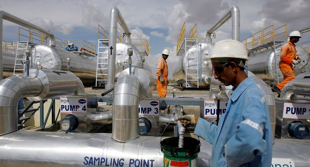 Cairn India employees work at a storage facility for crude oil at Mangala oil field at Barmer in the desert Indian state of Rajasthan August 29, 2009