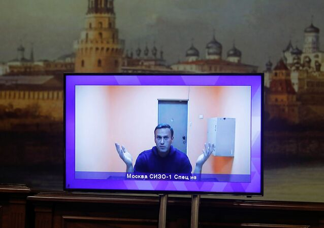 Russian opposition leader Alexei Navalny is seen on a screen via a video link during a court hearing to consider an appeal on his arrest outside Moscow, Russia January 28, 2021
