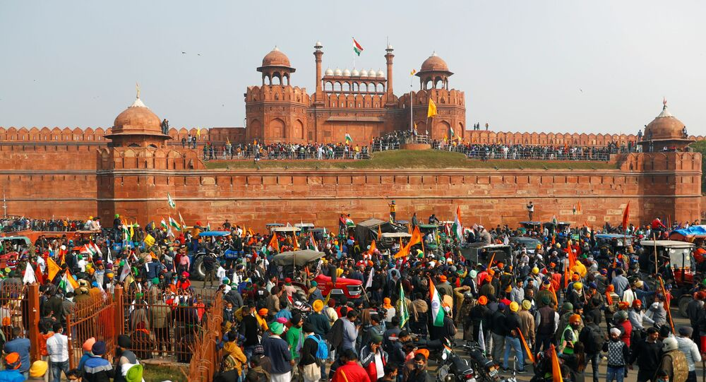 Farmers gather in front of the historic Red Fort during a protest against farm laws introduced by the government, in Delhi, India, January 26, 2021.