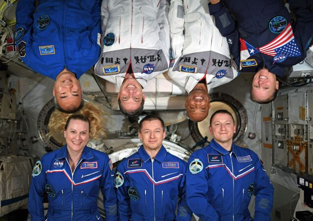 Members of the International Space Station (ISS) Crew