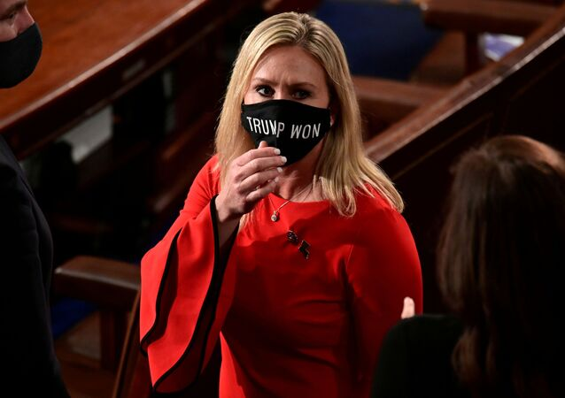 U.S. Rep. Marjorie Taylor Greene (R-GA) wears a Trump Won face mask as she arrives to take her oath of office as a member of the 117th Congress in Washington