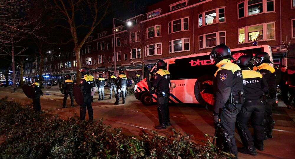 Police officers block a street during a demonstration against restrictions put in place to curb the spread of the coronavirus disease (COVID-19) in Rotterdam, Netherlands, January 26, 2021