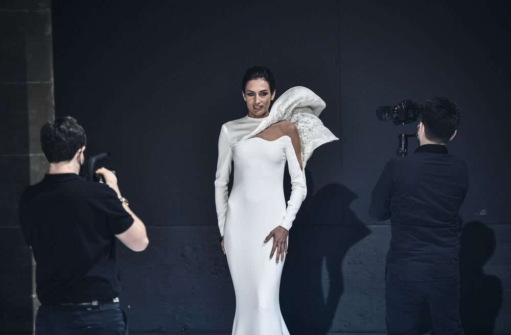 A model presents a creation by French designer Stephane Rolland during the shooting of a film designed to replace Haute Couture fashion shows in Paris on 18 January 2021 during the Covid-19 pandemic. With no catwalk fashion shows on offer, the artistic ambitions of fashion designers has gone virtual: the week of virtual fashion shows starts on 25 January 2021 in the French capital Paris, because of the Covid-19 pandemic.