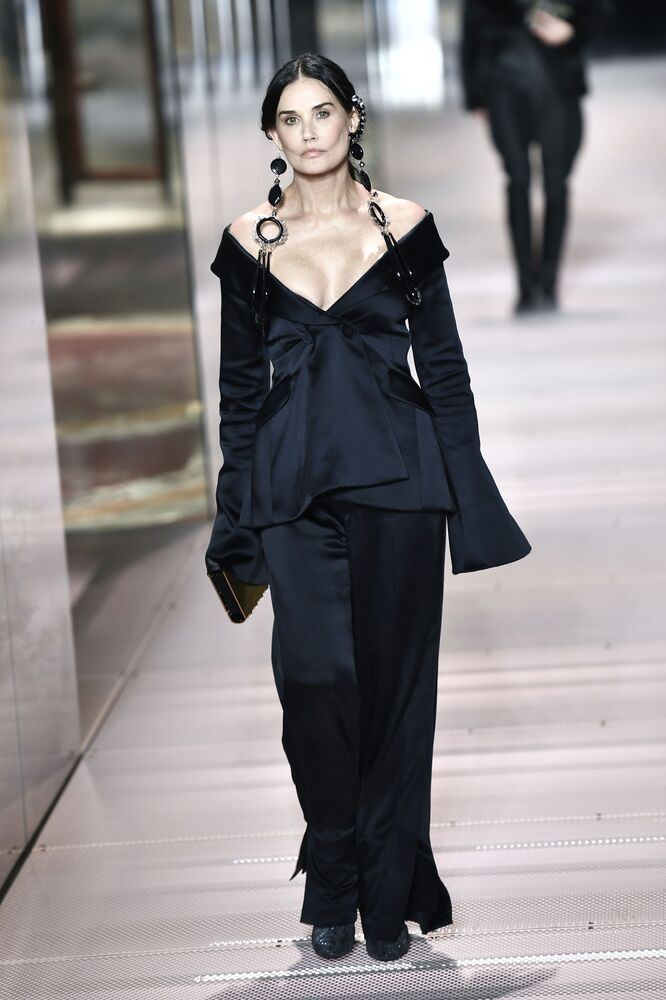 US actress Demi Moore presents a creation of British designer Kim Jones for Fendi's Spring-Summer 2021 collection during the Paris Haute Couture Fashion Week, in Paris, on 27 January 2021. British designer Kim Jones presents his first Couture Collection for Fendi since he joined the Italian fashion house as lead designer for womenswear in September 2020.