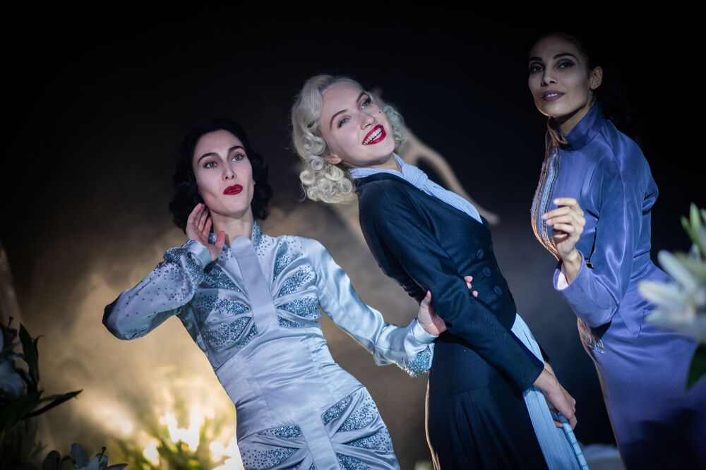 (From L) Greek model Angeliki Tsionou, Czech model Michaela Tomanova and French model Sheherazade Dakhlaoui take part in the shooting of a film to present French fashion designer Julien Fournié's Spring-Summer 2021 collection for the Paris Haute Couture Fashion Week, on 27 January 2021, in Paris which is held on online because of Covid-19 (novel coronavirus) pandemic restrictions.