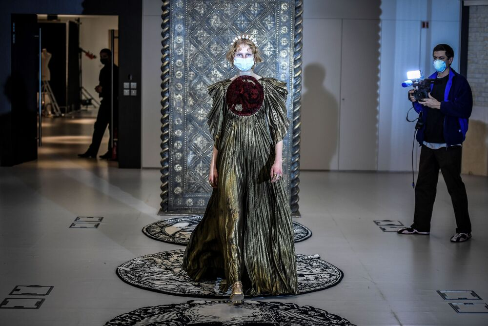 A model presents a creation by Christian Dior during a fitting session at Christian Dior's Haute Couture fashion house in Paris on 20 January 2021. With no catwalk shows possible because of COVID-19 restrictions, the event exists instead online: the week of virtual fashion shows starts on 25 January 2021 in the French capital Paris.