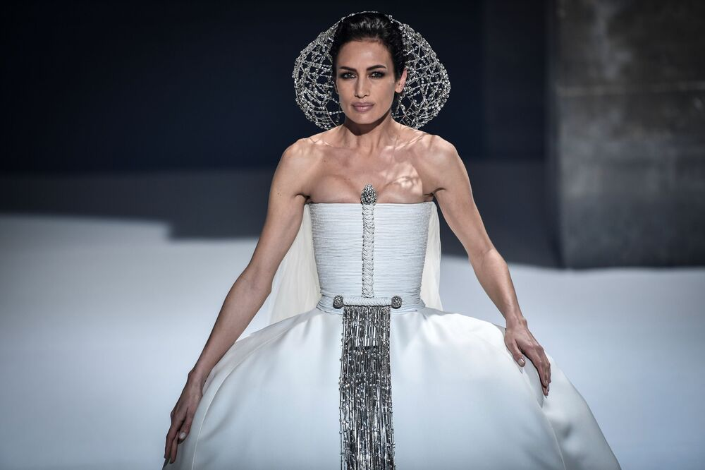 A model presents a creation by French designer Stéphane Rolland during the shooting of a film designed to replace Haute Couture fashion shows in Paris on 18 January 2021 because of the COVID-19 pandemic.