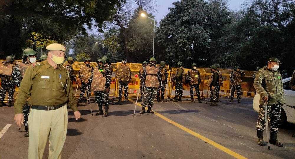 Security forces arrive at the site of the explosion near the Israeli Embassy in Delhi, India, on 29 January 2021.