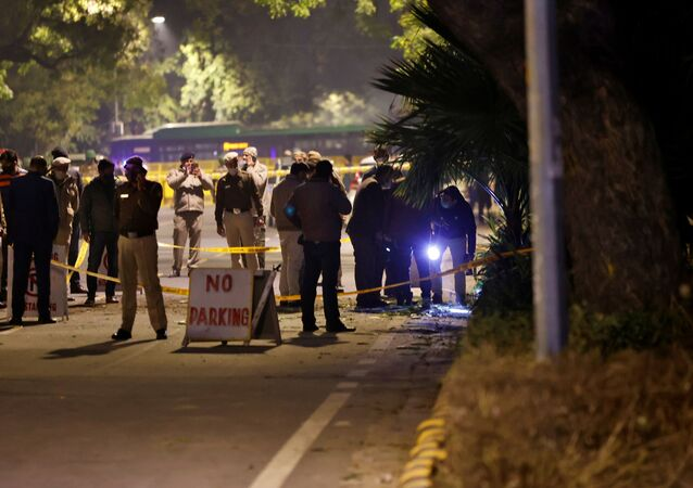 Police officials examine the site of an explosion near the Israeli Embassy in New Delhi, India, January 29, 2021. REUTERS/Danish Siddiqui